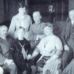 10.	Penfield Seiberling with his parents and siblings inside Stan Hywet Hall, circa late 1917. He and his siblings were the future donors of Stan Hywet; Fred's three children would serve as donors of his share. Seated, L-R: Virginia, F.A., Franklin, Gertrude, Willard, Irene. Standing, L-R: J. Penfield, Henrietta (Fred's wife). Source: Chapman Family.
